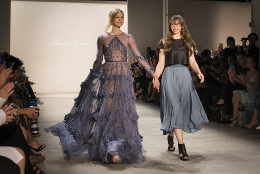 Deisgner Leanne Marshall with a model on the runway of her NYFW show