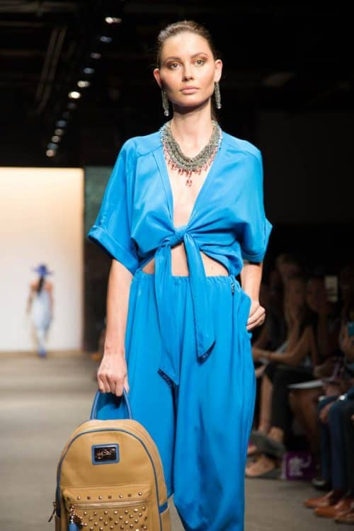 The Michelle Pajak-Reynolds necklace and earrings worn by Raven Symone featured on the runway at a NOLCHA Fashion Week event.